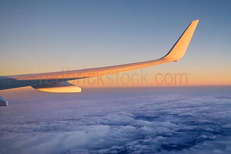 airliner;plane;aeroplane;wing;wingtip;fly;flying;above;clouds;cloud;early morning;sunrise;sun;rise;flight;travelling;journey;dawn;new day