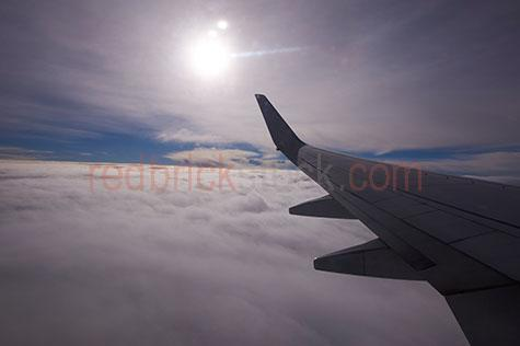 airline;airlines;airliner;airliners;aircraft;aircrafts;aeroplane;aeroplanes;plane;planes;jet;jets;passenger jet;passenger jets;aviation;flight;flights;fly;flying;flying over clouds;flying through clouds;above clouds;cloud;clouds;cumulus clouds;cumulus cloud;sky;skies;skys;wing;wings;plane wing;aeroplane wing;airline wing;airliner wing;wingtip;wing tip;travel;destinations;destination;vacation;vacations;holiday;holidays;looking out window;looking out airplane window;looking out aeroplane window;looking out plane window;looking out airliner window;window;dawn;sunrise;dusk;sunset;mood;moody;aerial;aerials;mid air;mid-air