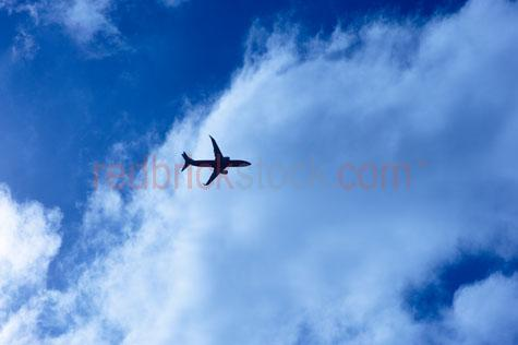 airport;aircraft;airliner;plane;boeing;747;qantas;flight maintenance;maintenance;transport;travel;repair;aeroplane;hanger;airline;fly;jet;safety;tarmac;flying into clouds;airline flying through clouds;flying through clouds