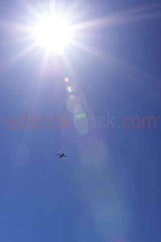 blue sky;blue skies;clear sky;clear skies;clear blue sky;clear blue skies;sun;sunburst;sunny;sunshine;day;day time;daytime;sun;sun ray;sun rays;flare;glare;copyspace;copy space;textspace;text spaceairliner;airliners;plane;planes;aeroplane;aeroplanes;airplane;airplanes;aircraft;aircrafts;transport;transports;transportation;transporting;flight;flights;fly;flying;in flight;commercial flight;commercial flights;commercial plane;commercial planes;plane flying;flying plane;planes flying;flying planes;plane in blue sky;planes in blue sky;plane in blue skies;jet;jet plane;jet planes;flying over;plane flying overhead;plane flying over head;planes flying over head;planes flying overhead;travel;travels;traveling;holiday;holidays;vacation;vacations;daylight;day light;sun light;sunlight;blue;blues;colour blue;color blue;silhouette;silhouettes;silhouetted