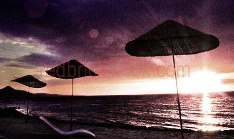 beach umbrella umbrellas travel sunset sun set ocean sky skies s