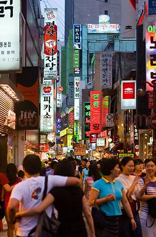 seoul streetscape;seoul street scape;south korea;asia;asian streetscape;neon lights;neon light;people;large population;city;cities;major city;major cities;city lights;advertisements;signs;signage;shopping;asian culture;western culture