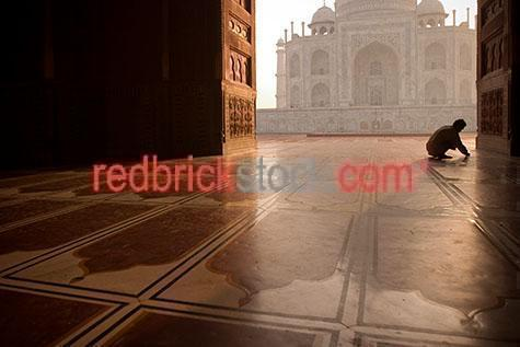 taj mahal;india;agra;travel;travels;travelling;traveling;travelled;traveled;tourist destination;tourist destinations;holiday destination;holiday destinations;vacation;vacations;tourism;icon;icons;iconic;landmark;landmarks;iconic building;landmark building;asia;asian;buildings;building;architecture;architectural;muslim;dome;domes;mausoleum;mausoleums;islam;islamic;person;one person;one figure;cleaning;cleans;clean;silhouette;silhouettes;silhouetted