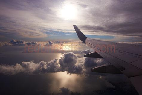 airline;airlines;airliner;airliners;aircraft;aircrafts;aeroplane;aeroplanes;plane;planes;jet;jets;passenger jet;passenger jets;aviation;flight;flights;fly;flying;flying over clouds;flying through clouds;above clouds;cloud;clouds;cumulus clouds;cumulus cloud;sky;skies;skys;wing;wings;plane wing;aeroplane wing;airline wing;airliner wing;wingtip;wing tip;travel;destinations;destination;vacation;vacations;holiday;holidays;above ocean;looking out window;looking out airplane window;looking out aeroplane window;looking out plane window;looking out airliner window;window;dawn;sunrise;dusk;sunset;mood;moody;aerial;aerials;mid air;mid-air